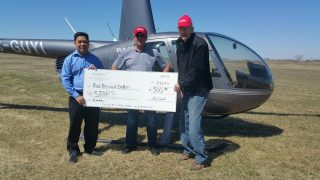 Saskarc presents check to Stars